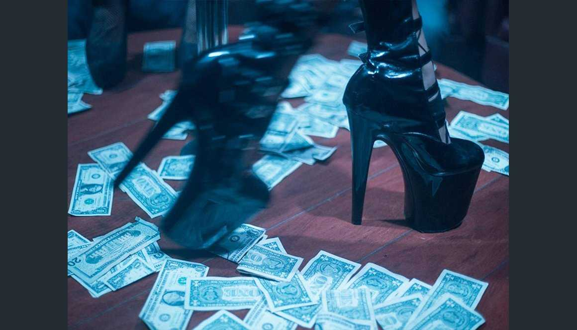 False Nails and Dollar Bills: the Woman Photographing Strippers How They Want to be Seen
